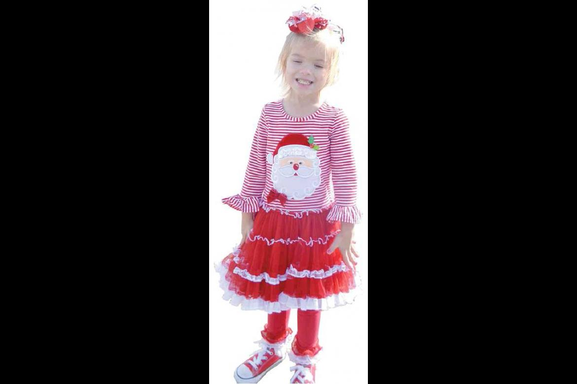 LOOKING BEAUTIFUL IN HER CHRISTMAS DRESS at the Tupelo Christmas Celebration was Everly Miller.